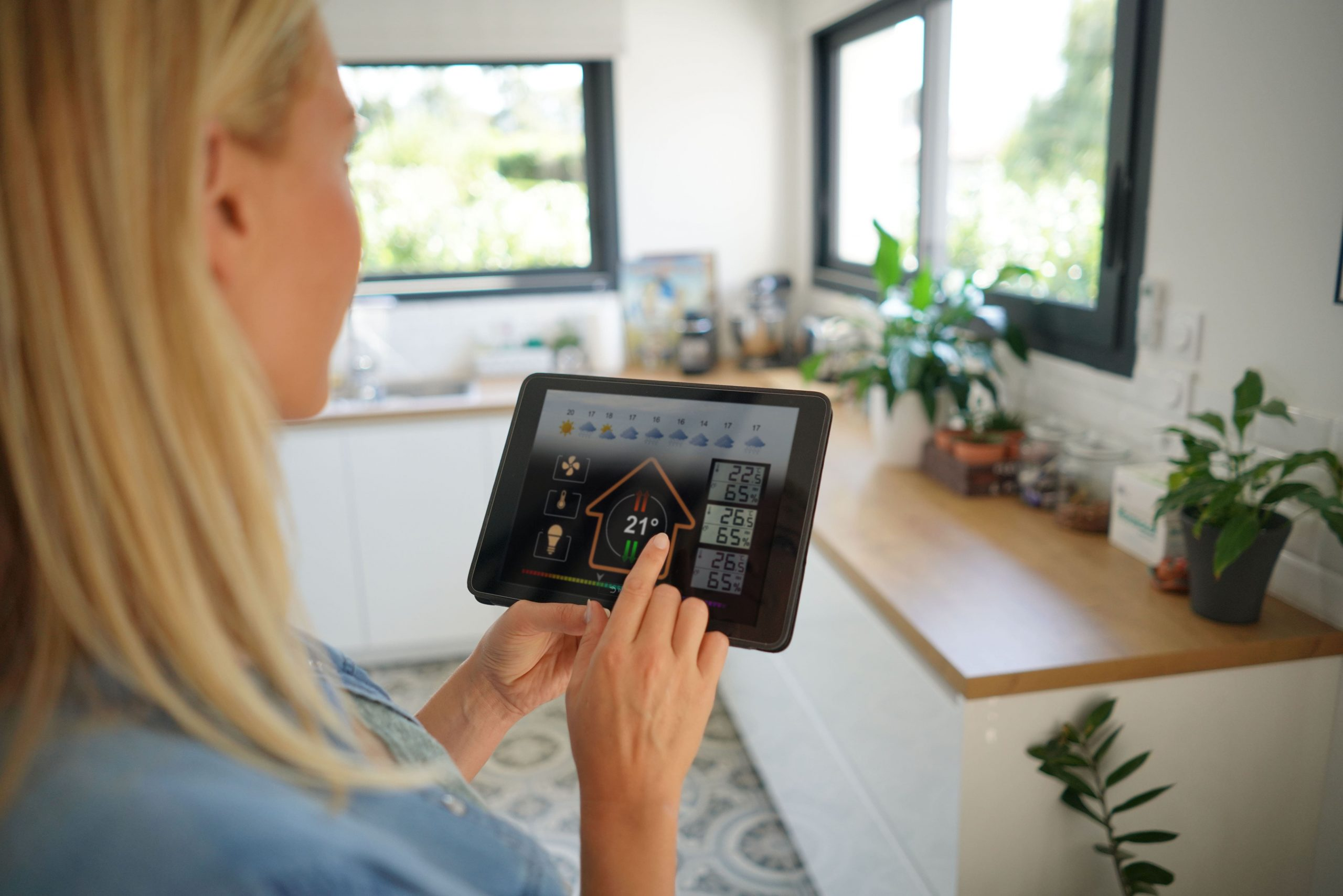 woman using tablet app for smart homes
